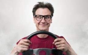 man holding a steering wheel